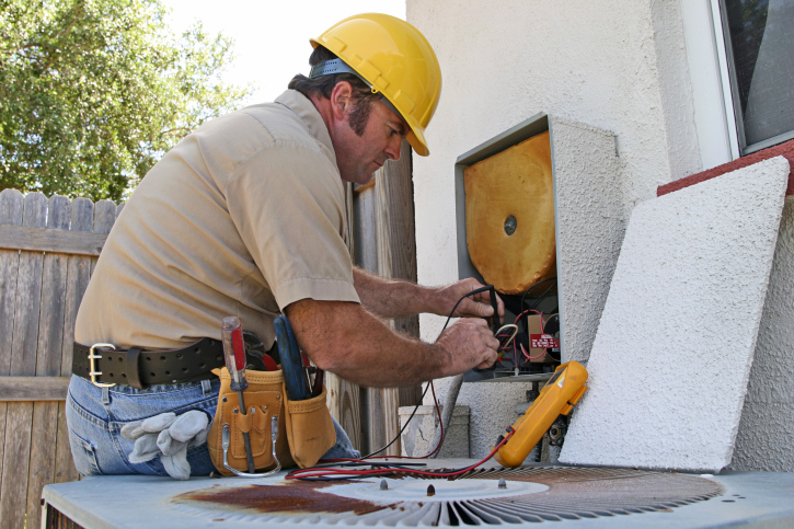 Air Conditioning Repairman Runs Tests